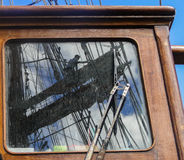Reflection in window of sailboat, working aloft Royalty Free Stock Photography