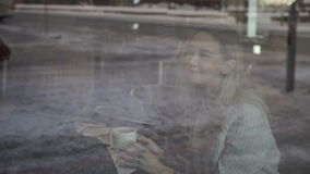 Reflection in a window of two girls in a cafe stock video