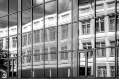 Reflection in the windows of another building black and white Stock Photo