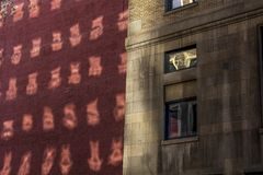 Reflection of windows on exterior wall of brick and stone commercial office building in city royalty free stock photos