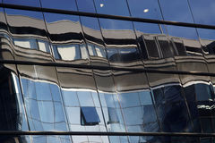 Reflection in windows of modern building Stock Photos
