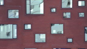 Reflection in a windows. Moving reflection in a windows of a red brick building. Details of modern architecture. Contemporary urban facade stock video