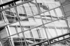Reflection in the windows of an office building. Black-and-white Stock Photography