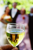 Reflection- Wine glass. People at wedding reception reflected in wine glass stock images