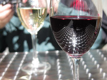 Reflection in a wine glass. Polished steel table facets Reflecting in a glass of redwine Royalty Free Stock Images