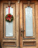 Reflection of winter. Decorated door around Christmas time stock photo