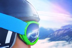 Reflection of the winter mountain landscape in a ski mask.  Stock Photography