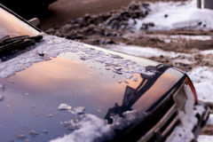 Reflection winter pink sky in hood of the car Royalty Free Stock Photography