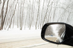 Reflection of winter road Stock Photos