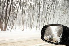 Reflection of winter road Royalty Free Stock Photo