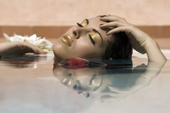 Reflection of a woman laying on water Stock Images