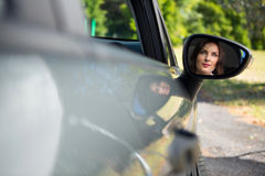 Reflection of woman in wing mirror driving a car Royalty Free Stock Photography