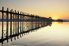 Reflection Wooden U Bein Bridge in the morning sunrise. U Bein Bridge is the longest wooden bridge Royalty Free Stock Image