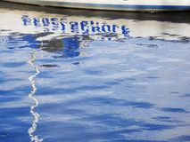Reflection of word Sailing school royalty free stock photos