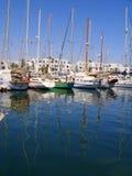 Reflection of Yachts Port El Kantaoui Marina Tunisia. Luxury yachts and their masts reflected in the deep blue water of Port El Kantaoui Marina, Tunisia Stock Photo