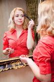 Reflection of young woman in a mirror Stock Photo
