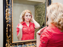 Reflection of young woman in a mirror. Reflection of young woman in a big mirror Stock Image