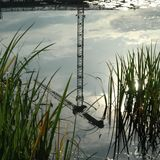 Reflection of crane stock photography