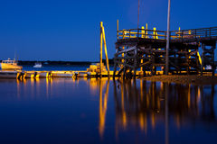 Reflections. Of an elevated dock at sunset Royalty Free Stock Photo