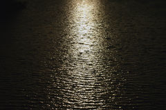 Reflections. Moon reflecting on an expanse of water royalty free stock photography