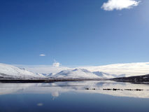 Reflections at Akureyri. Reflections of the sky and mountains in the sea at Akureyri, Iceland stock photography