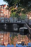 Reflections of Amsterdam. Row homes and reflections in canal royalty free stock photos
