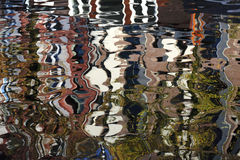 Reflections in Amsterdam canal Stock Image