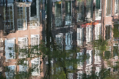 Reflections in the Amsterdam canal Stock Photos