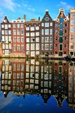 Reflections of Amsterdam. Iconic canal houses of Amsterdam with vibrant reflections, Netherlands stock photos