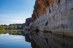 Reflections of the ancient Devonian limestone cliffs of Geikie Gorge where the Fit. Stunning Devonian limestone cliffs of Geikie Gorge where the Fitzroy River stock photos