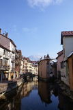 Reflections in Annecy France. A less conventional view of the waterways of abject France with mediaeval buildings reflected in the Crystal clear alpine waters Royalty Free Stock Photos