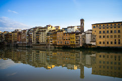 Reflections on the Arno. Reflections of the surrounding buildings on the river arno Royalty Free Stock Photo