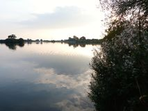 Reflections at attenborough. The sun setting over attenborough nature reserve Stock Images