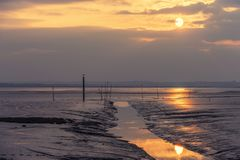 Reflections at the bassin d`Arcachon. The sun reflected in the water and the mud that was visible during this very low tide at the bassin d`Arcachon Royalty Free Stock Photo