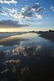 Reflections on the beach stock photos