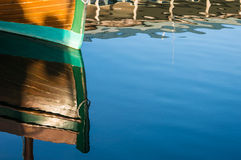 Reflections of a beautiful wood boat. Stock Images