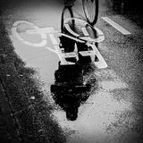 Reflections of a bicycle in Amsterdam Stock Images