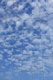 Reflections of blue sky and clouds Royalty Free Stock Images