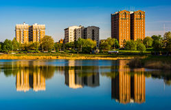 Reflections of buildings in Druid Lake, at Druid Hill Park, in B Royalty Free Stock Photo