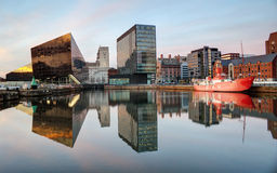 Liverpool Docks with Reflections. Reflections of buildings and moored ship in Liverpool Dock, England royalty free stock image