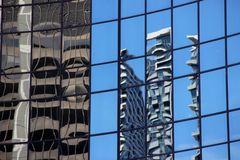 Reflections of buildings. Buildings refelected in windows against a blue sky  in Chicago Stock Photos