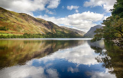 Reflections in Buttermere in Lake District. Mountains reflect into Buttermere calm lake in English Lake District Royalty Free Stock Photos