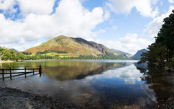 Reflections in Buttermere in Lake District. Mountains reflect into Buttermere calm lake in English Lake District Stock Photo