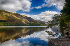 Reflections in Buttermere in Lake District. Mountains reflect into Buttermere calm lake in English Lake District Stock Photography