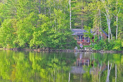 Reflections of a Cabin on the lake Stock Photos
