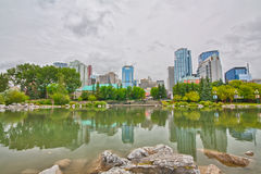 Reflections of Calgary Cityscape. Cityscape of Calgary reflected in the lagoon at Prince's Island Park on an overcast day Royalty Free Stock Photography