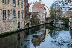 Reflections in the canal in Bruges, Belgium Royalty Free Stock Image