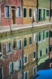 Canal reflections, Burano, Italy Royalty Free Stock Image