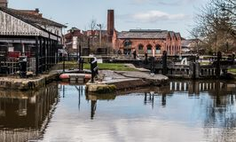 Reflections and Dry Dock. The reflections on the canal with the dry dock in view Royalty Free Stock Photos
