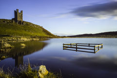 Reflections and castle ruins Stock Photo